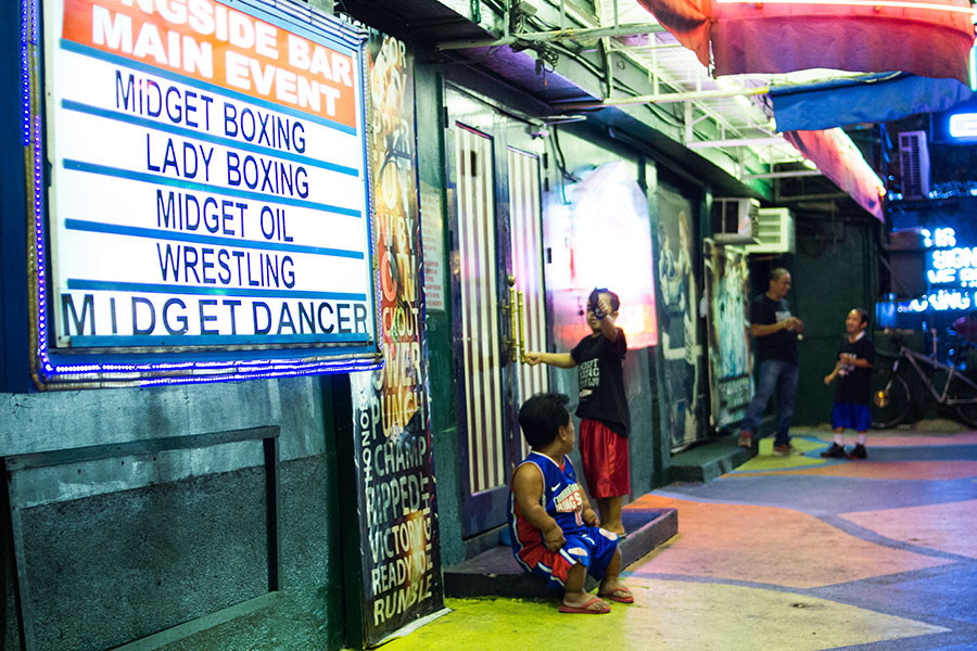 PICTURES: P. Burgos, Early Hours of a Red-Light District in Makati City