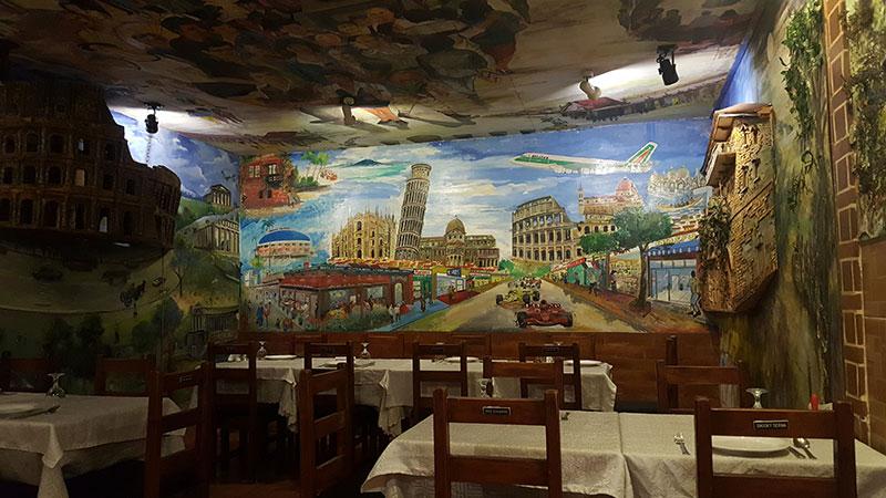 Wall art of Italian landmarks at Bellini's